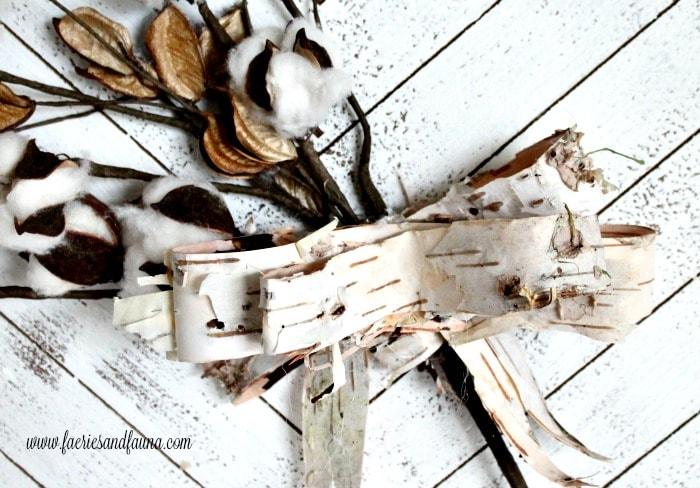 Beautiful birch bark being made into a birch bark ribbon for fall decor.