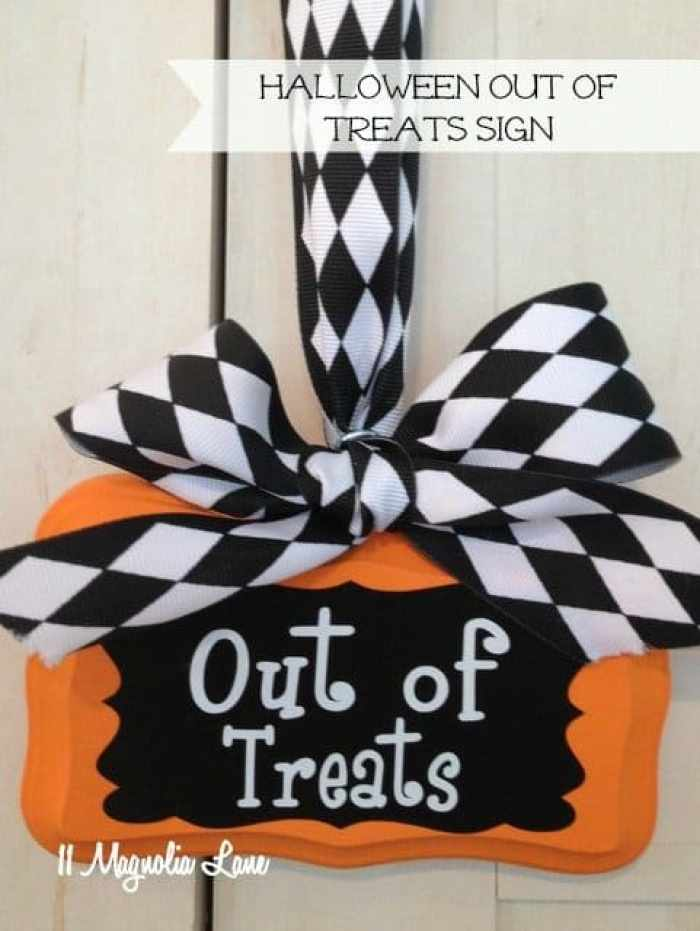 Halloween craft sign for the front door that says out of treats