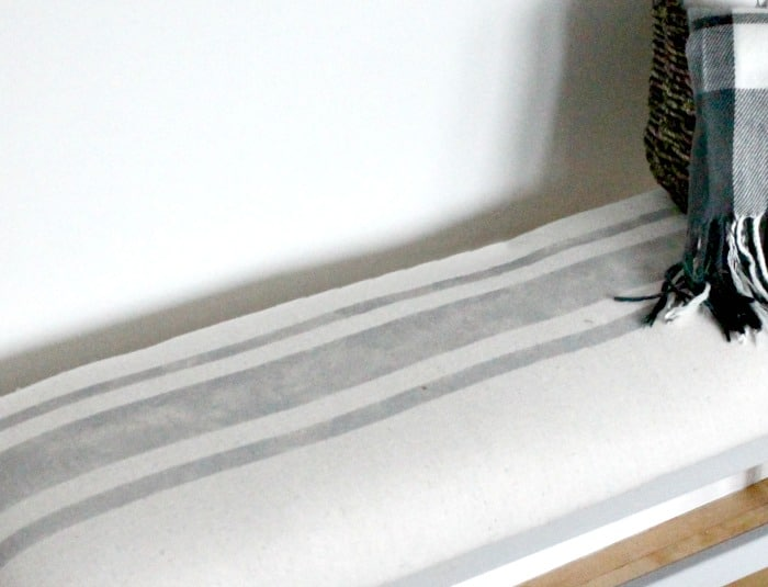 Hand made painted stripes on a farmhouse bench makeover.
