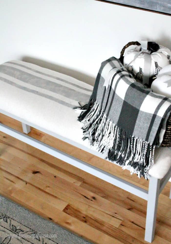 DIY Farmhouse bench with simple painted stripes.