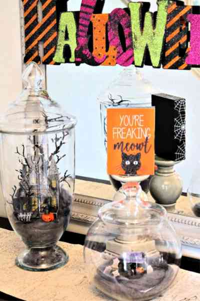 Halloween decor using Halloween apothecary jars in a haunted house and graveyard theme.