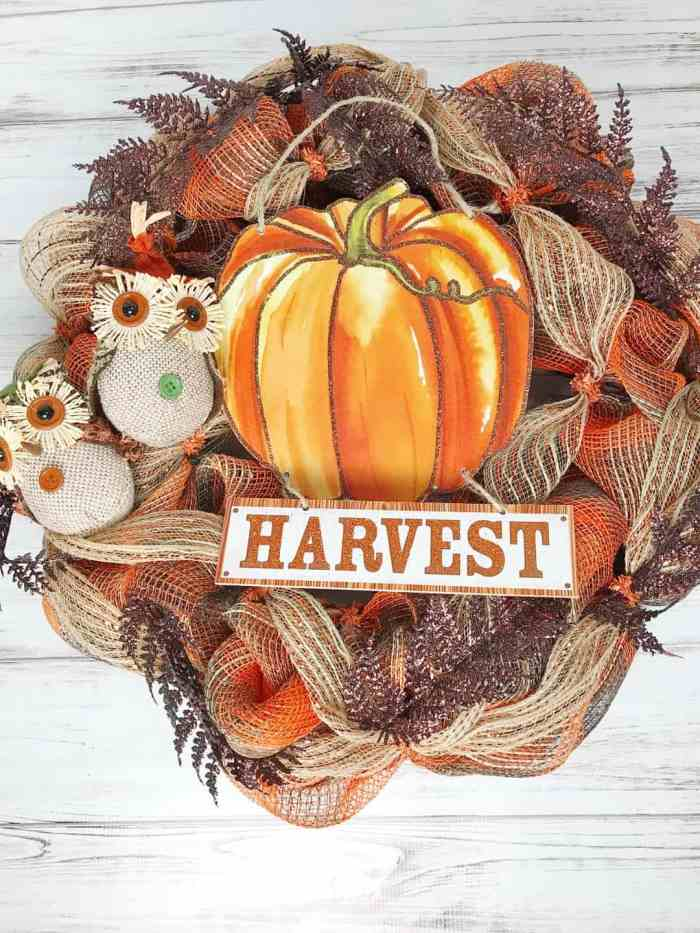 DIY Fall Wreath made using Deco Mesh in traditional fall colours.