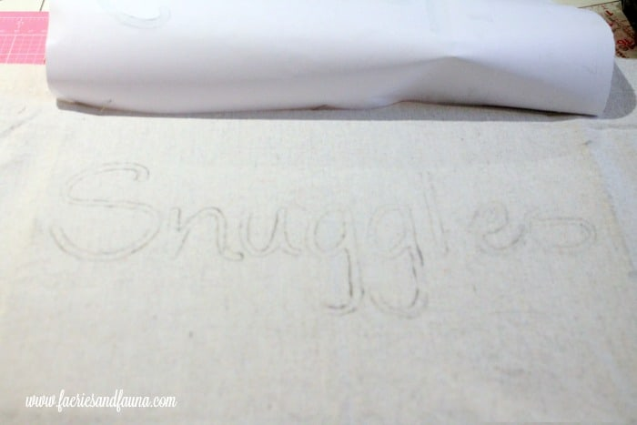 Wording pattern that has been transferred onto a DIY pillow for Christmas decorating.