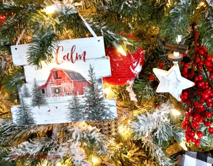 All is Calm white Christmas Tree decorations . Farmhouse Christmas tree decorations with barns, and sayings.