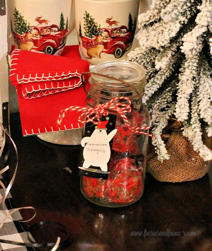 Christmas mason jar with chocolate covered spoons.