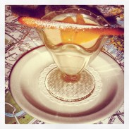 Blood orange posset from Brasserie Blanc sitting over a map of central London