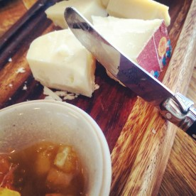 A close up of the cheese board.