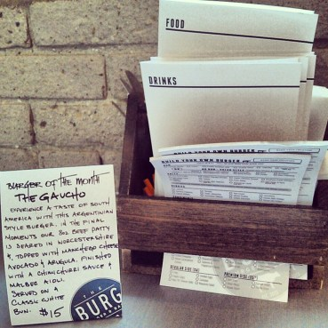 The menu rack and Burger of the Month card.