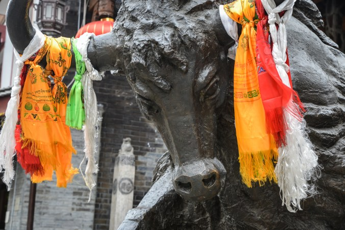 Impressive and pointedly male yak statue in downtown Kangding.