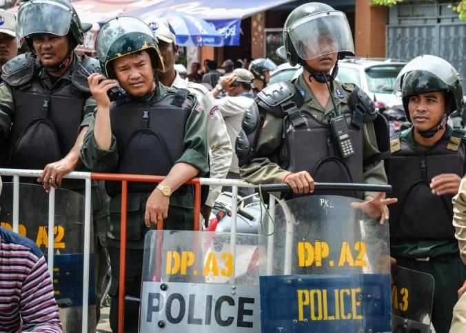 Bored riot police at Wat Botum.