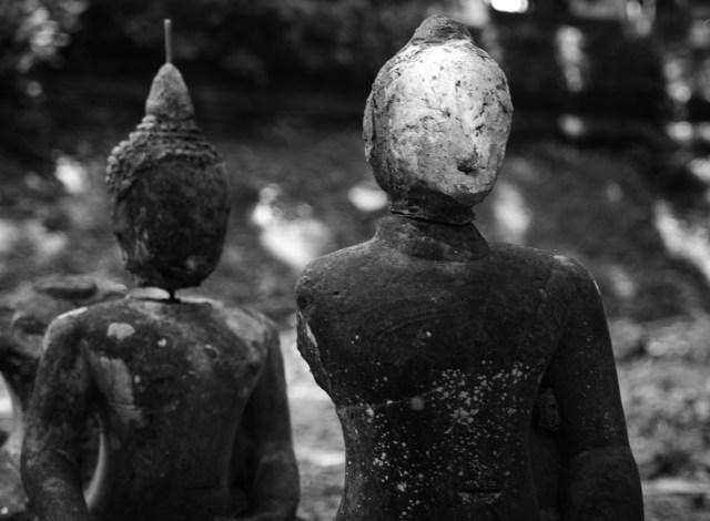 Faceless stone Buddhas.