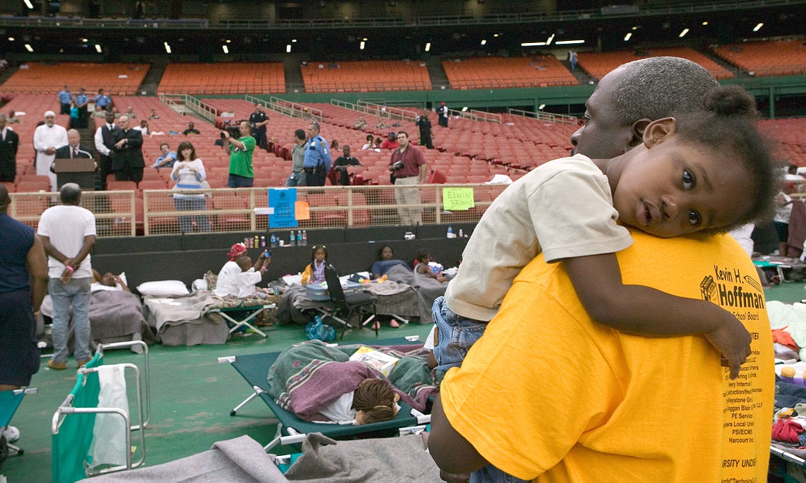 Katrina survivors in the Astrodome (photo: Andrea Booher/FEMA)