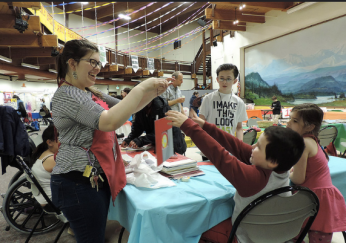 E.D., Jess Peña, helps out at Very Special Arts Festival