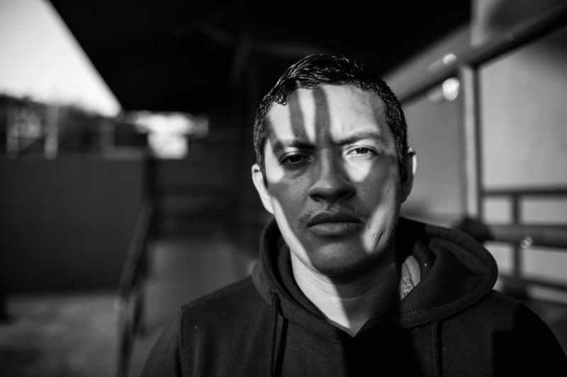 monochrome photo of man wearing hoodie