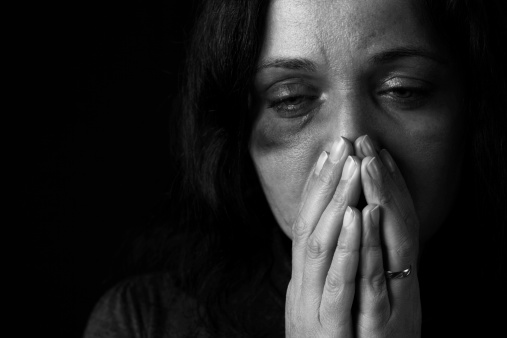 Domestic violence victim, a young woman being hurt
