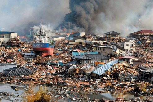 A destroyed section of the Japanese coastal city of Kesennuma, in Miyagi Prefecture, the day after the Tohoku earthquake and tsunami, March 2011
