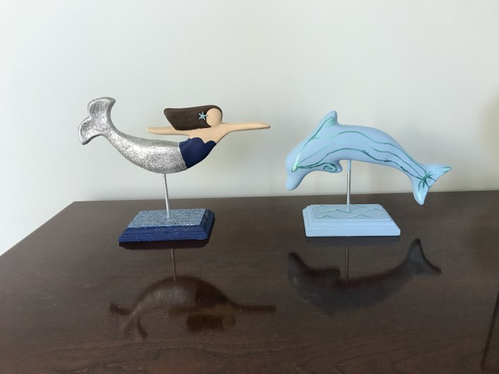 Ceramic mermaid and dolphin from The Mermaid Factory in Norfolk, VA | Fairly Southern