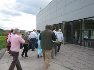 Entering the museum and cafe. Friends of the Timberwolves Hank, wife Josay (sp?), Piet, and others have driven about 5 hours from Holland to join us.