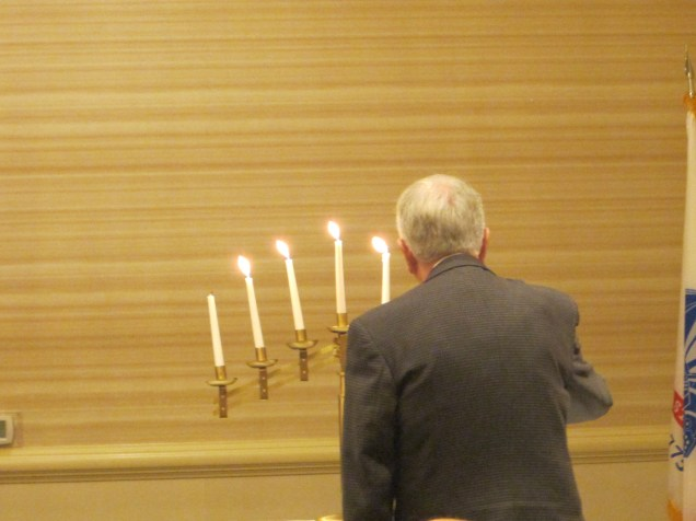 Putting out the candles to remember fallen comrades.