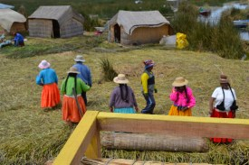 The Uros women, always colourfully dressed, greet tourists with a little sing-song