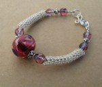 Silver knit with lampwork glass by Robyn