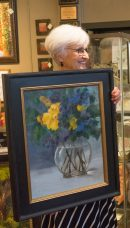 Joan displays art by Melissa Jander.