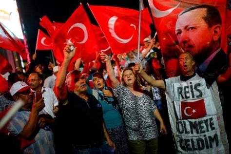 People shout slogans and wave Turkish national flags as they have gathered in solidarity night after night since the July 15 coup attempt in central Ankara, Turkey, July 27, 2016. REUTERS/Umit Bektas