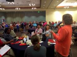 Cinda Stenger of Alki UCC addresses the room