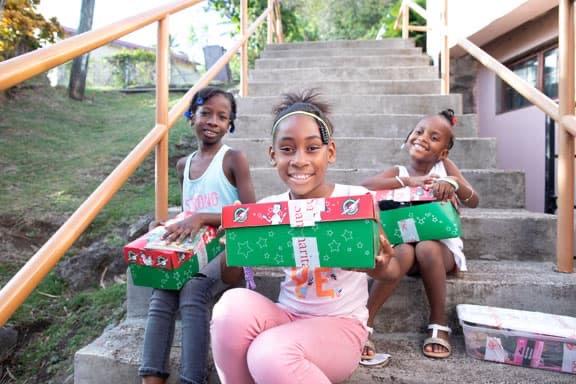 Girls holding shoebox