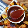 Simple potatoes go from ordinary to extraordinary by being boiled, roasted, and then drizzled with and served alongside spicy ketchup.