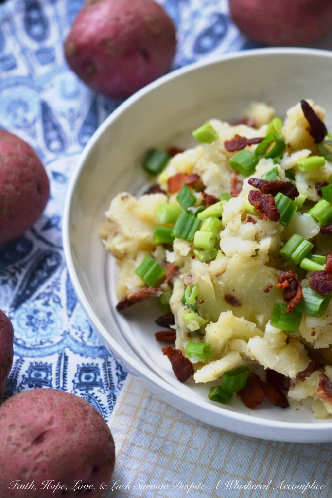 This hot potato salad is given a sweet and tangy German twist by using a simple Dijon and whole grain mustard vinaigrette along with crispy crumbled bacon.
