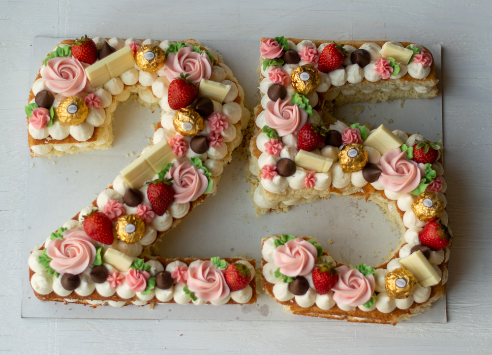 number 25 cake with strawberries and candy