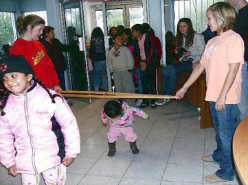 Kids playing limbo at a Christmas fiesta in Reynosa