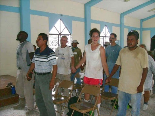 A team and volunteers worshipping together in Reynosa