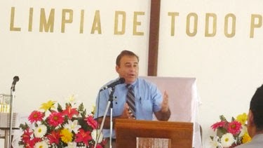 David preaching at a church celebration in Miguel Aleman
