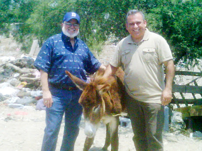 Deantin and David with a donkey in Mexico