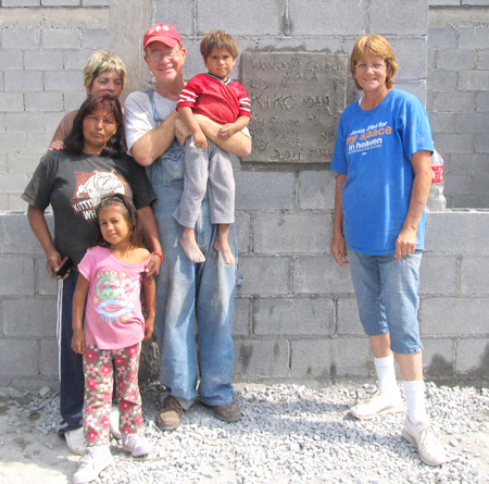 Mission work group with the family receiving a house