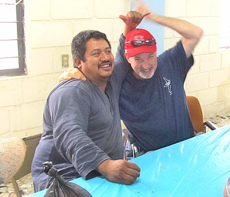 A Mexican volunteer and a Board member joking around in Reynosa