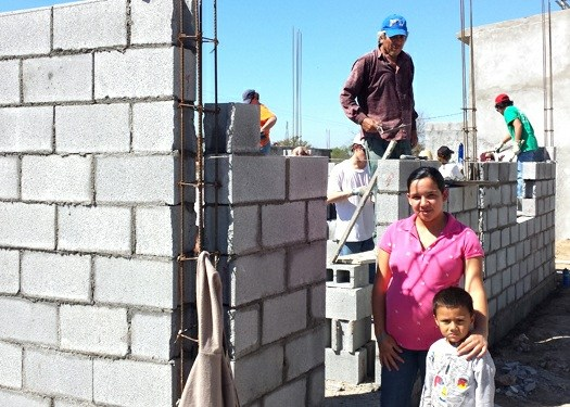 A family whose house is being built in Mexico
