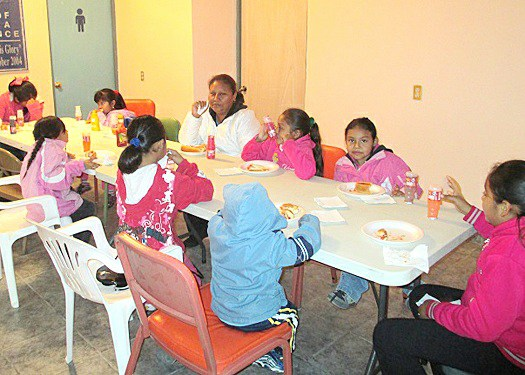 Kids enjoying a meal at the nutrition program in Miguel Aleman