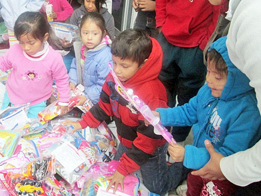 Kids getting gifts at the Christmas fiestas in Reynosa