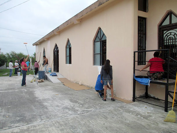Painting the church in Miguel Aleman