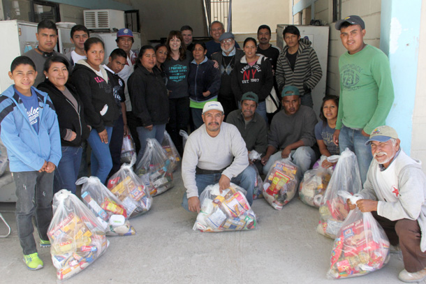 Volunteers and staff with their Christmas groceries in Reynosa
