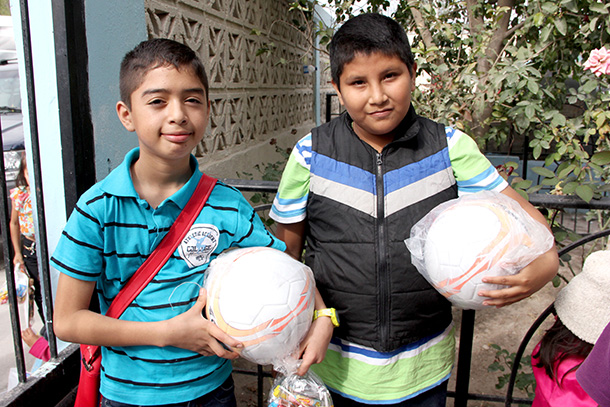 Kids with their soccer balls at the Christmas fiesta in Reynosa