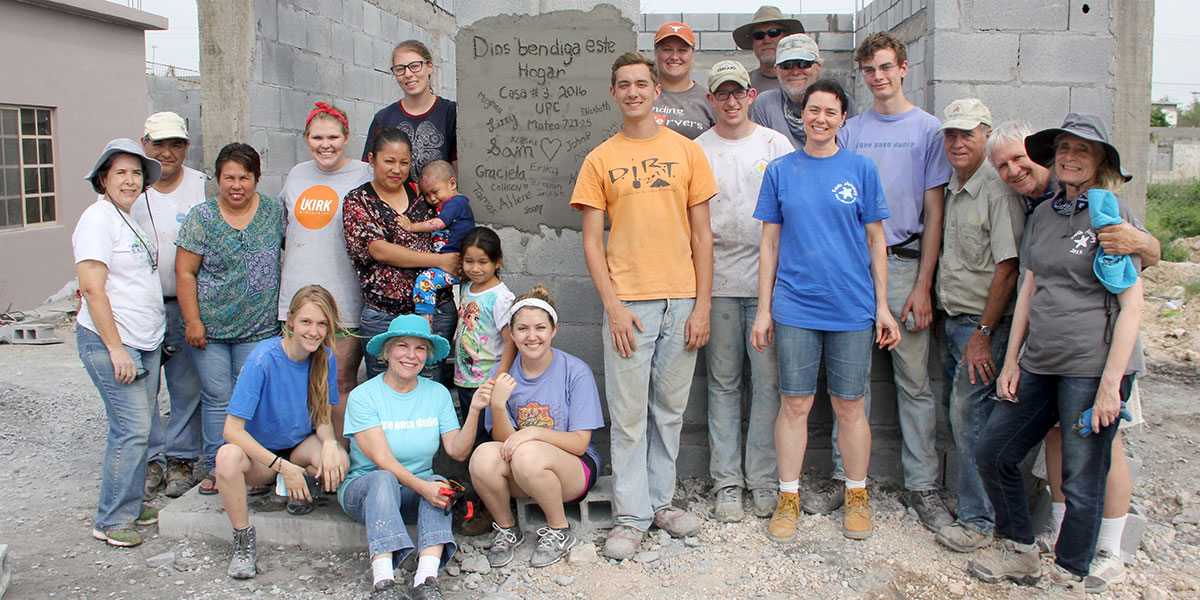 A group and a family in front of completed house in Reynosa