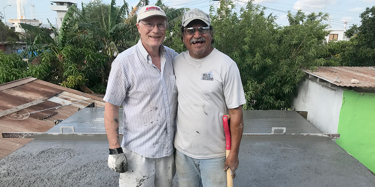 Friends working together to pour a roof in Reynosa