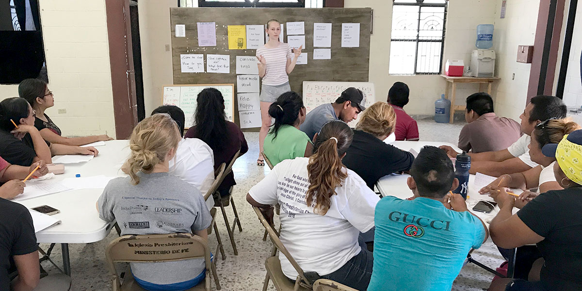 Our summer intern LIzzy teaching English to the volunteers in Reynosa