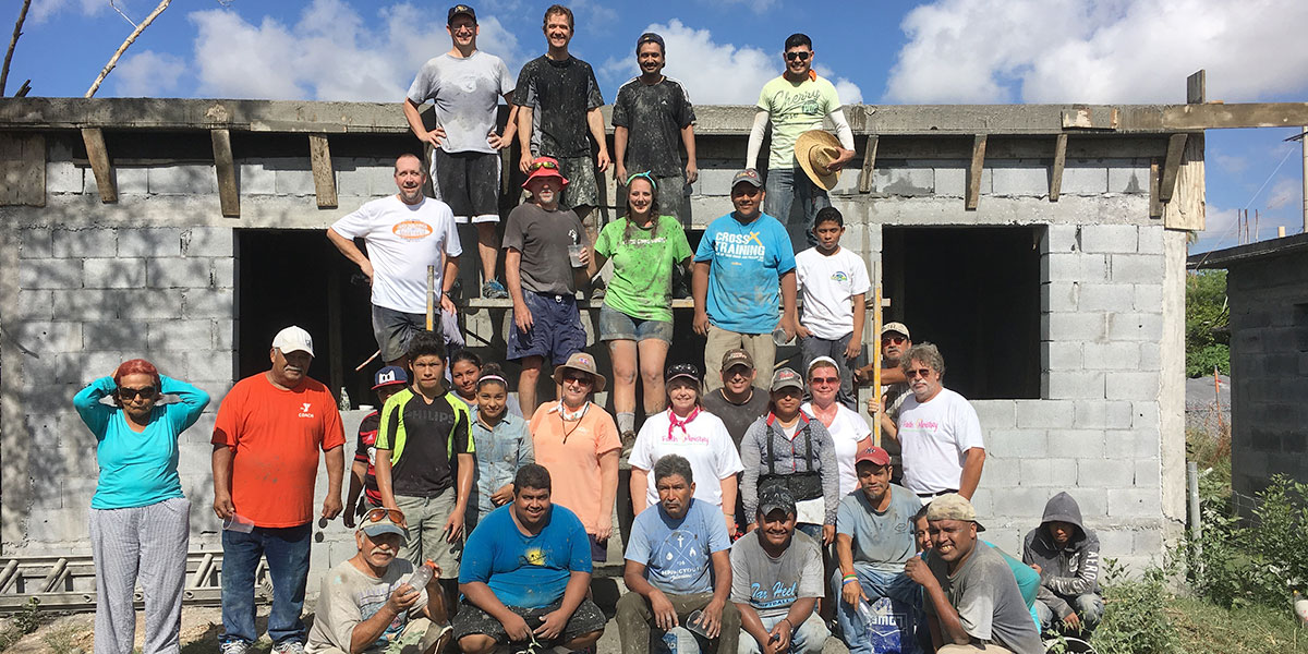 The Board of Directors with the staff and volunteers after pouring a roof in Reynosa