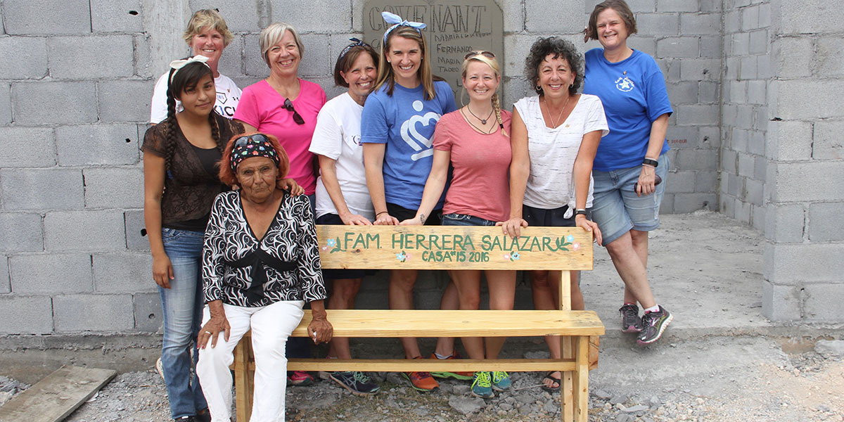 A team from North Carolina with the family and a bench built in the woodworking shop