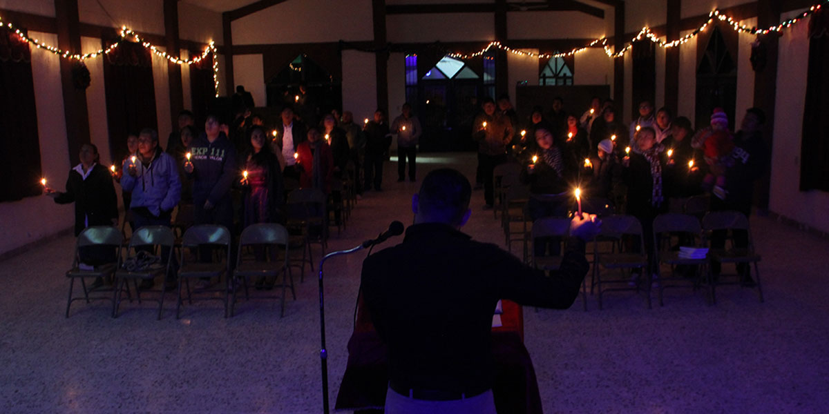 Singing Silent Night by candlelight at the Christmas fiesta in Reynosa